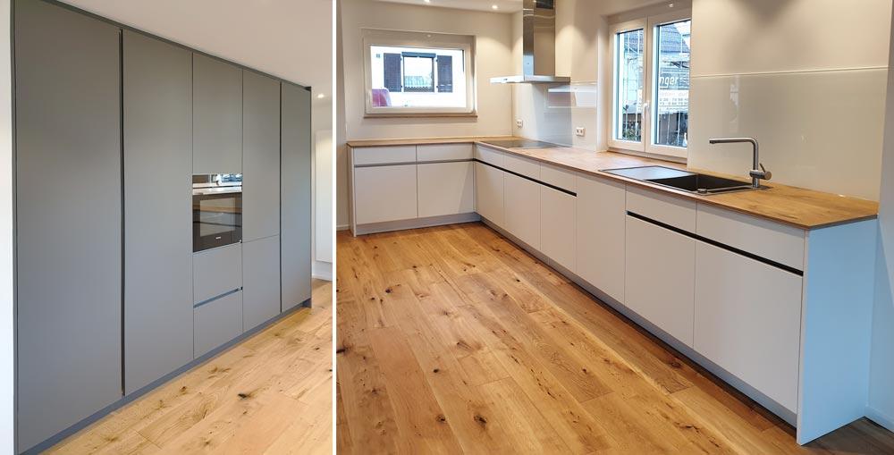 Küche in weiß und grau mit Arbeitsplatte in Risseiche